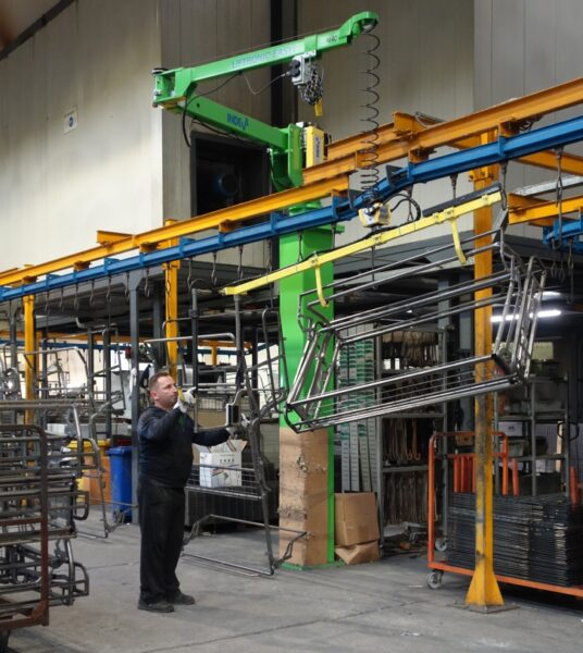 Just one operator can lift and move a sofa frame using an INDEVA manipulator